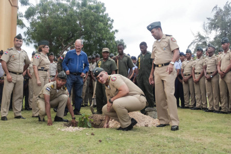 Cadets plant bird-friendly trees at Batle of Las Carreras Military Academy in the Dominican Republic.