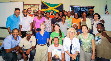 Group photo of workshop participants in Albert Town: In front: Damian Parchment and Ann Sutton. Second row, left to right: Llewelyn Meggs, Gary Campbell, Wendy Lee, Holly Robertson, Dario Codling, Lisa Sorenson, and Beny Wilson. Standing: Rick Morales, Junior Carson, Kerian Vernon, Nasheeka Blackstock, Howen Campbell, Melesia Brown, Anna Riggon, Jason Stariwat, Jermy Schroeter, Ainsworth Smith, Leno Davis, Conroy James, Jermaine Sitcheron, Adrian Watson, Samdeka Codling, Ronald Homes, Julia Porter, Brian Coore, Rayon Skeene and Andrew Hall.