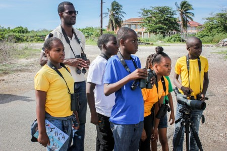 What kind of bird is that? Students of Denham Town Primary with a little help from resident bird expert at National Environment & Planning Agency, Ricardo Miller (second left) were able to identify 5 species of birds at the Old Coal Wharf in the Palisadoes Port Royal Protected Area as part of a bird count held recently in celebration of International Migratory Bird Day, October 9.