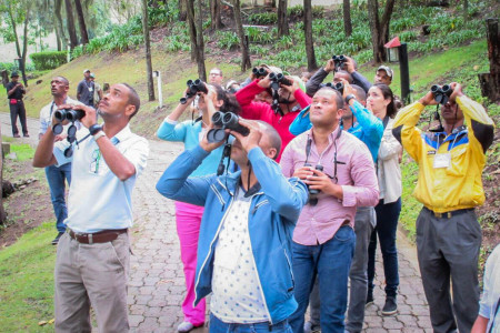 Participants learning how to use their new Vortex binoculars. (Photo by Beny Wilson)