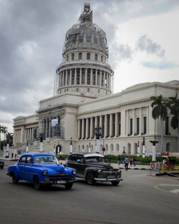 Capital and old cars in Havana. (Photo by Margaret Kinnaird)