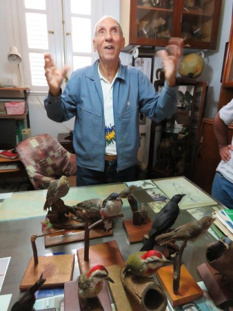 Emeritus ornithologist and living legend, Orlando Garrido, sharing stories from the field while showing us his endemic bird collection (Photo by Susan Jacobson)