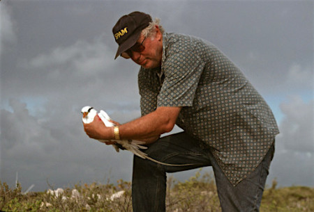 Dave Lee holding a White-tailed Tropicbird in the Bahamas.