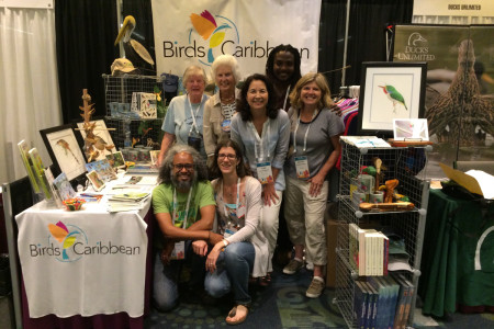 Our Caribbean flock gathers at our BirdsCaribbean booth, a popular spot in the Exhibition Hall - Kate Wallace, Erika Gates, Lisa Gates, Lisa Sorenson, Wayne Smart, Jennifer Wheeler, Howard Nelson and Ellie Devenish.