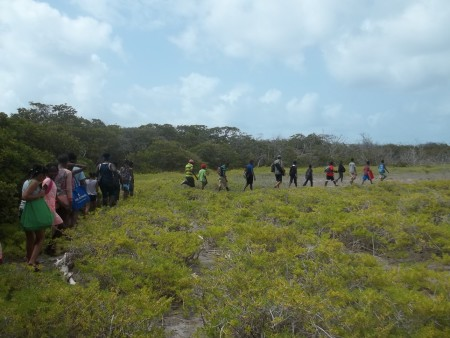Birding trainees from 4 primary schools enter the Bird Sanctuary of Petit Carnage. (photo by Marina Fastigi)