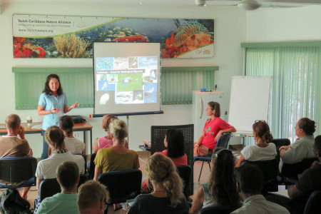 Lisa Sorenson, Executive Director of BIrdsCaribbean, talks about the many migratory and resident birds that can be found on Bonaire. (photo by Holly Robertson)