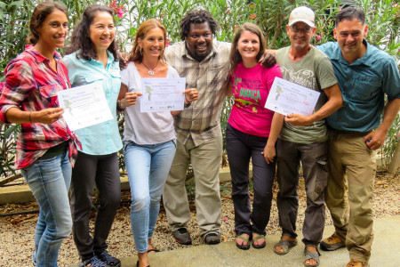 Newly-trained guides from the Mangrove Information Center pose with facilitators and their Certificates of Completion for the CBT Guide Training. L to R: Janet Koek, Lisa Sorenson, Elly Albers, Beny Wilson, Holly Robertson, Mick Arts, Rick Morales.