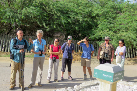 Trainer Rick Morales explains how to guide a group on a trail before the morning birding walk at Dos Pos. (photo by Lisa Sorenson)