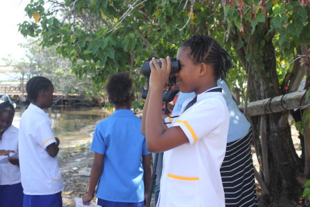 Port Royal Primary School students in Jamaica learned how to use binoculars for a field trip to view seabirds. (Photo by Ava Tomlinson, NEPA - Jamaica)