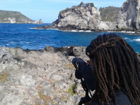 David S. Lee Fund award recipient, Grenadian Wayne Smart, scans for seabirds in the Grenadine islands with his spotting scope.