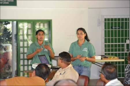 "Kareena Anderson and Laura Baboolal CLiC ""Team Traffic"" members giving a presentation to enforcement personnel of the Wildlife Section, Trinidad and Tobago. (Photo by Praimchand Anderson)"