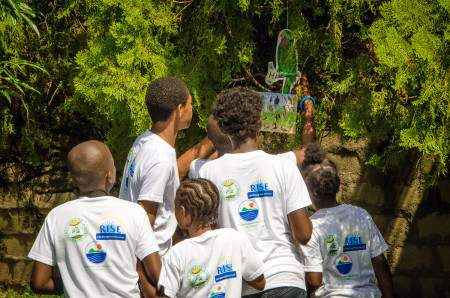 "Young ""bird sleuths"" in Jamaica play the Bird Detective Game (Lesson 8) in BirdSleuth Caribbean curriculum. (photo courtesy of Jamaica Environment Trust)."
