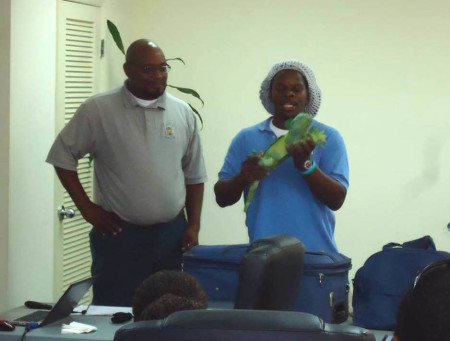 "Scott Johnson, CLiC ""Team Traffic"" member and BNT Science Officer speaks to Bahamian and Turks  and Caicos Islands enforcers on wildlife smuggling during a workshop. (Photo courtesy of Scott Johnson)"