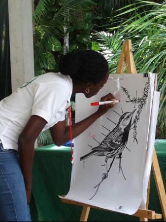"Carisha Thomas (Education Conservation Outreach -ECO, Grenada) demonstrates ""Learning the parts of a bird""(Lesson 8). (photo by Lisa Sorenson)"