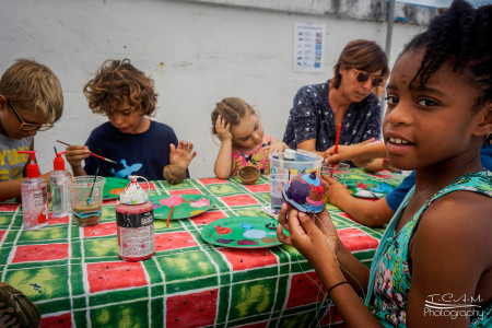 On St. Martin, festival attendees painted bird feeders to bring home. (Photo by Tim Chin)