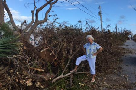 Erika Gates inspects damage at Sea Gate Lane.