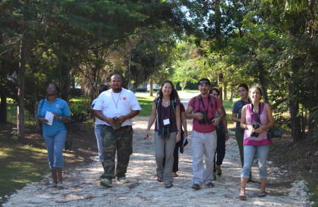 Workshop participants and faciliators enjoying a birding walk at The Retreat, Bahamas National Trust, Nassau, Bahamas.
