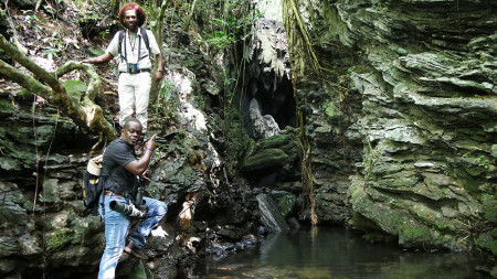 Two St. Lucian delegates, Valance (Vision) James and Adams Toussaint, pose at the gorgeous entrance of Gruta Batata, a cave with pools and waterfalls. (Photo by Jessica Rozek)