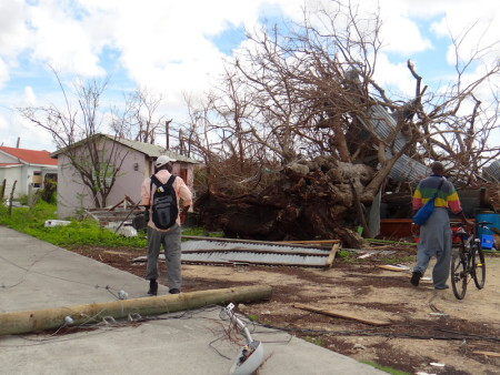 Joseph Prosper walking through town in Barbuda surveying the catastrophic damage from Hurricane Irma and searching for Barbuda Warblers. All residents have been temporarily evacuated. (photo by Andrea Otto).