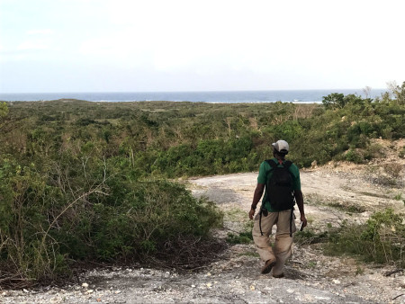 Lenn Isidore looking out over the coastal scrub near Two Foot Bay (Photo by Jeff Gerbracht)